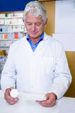 Pharmacist holding a prescription and medicine Stock Images