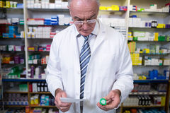 Pharmacist holding a prescription and medicine Stock Image