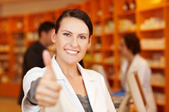 Pharmacist holding thumbs up Stock Image