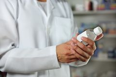 Pharmacist holding a tincture Stock Image