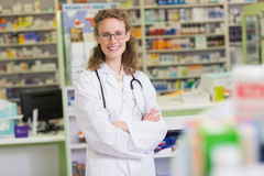 Pharmacist in lab coat with stethoscope and arms crossed Stock Photography