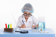 Pharmacist in lab writing a notebook Royalty Free Stock Photos