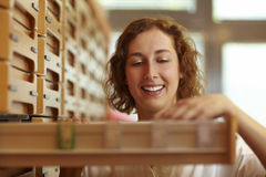 Pharmacist looking in drawer Stock Photography