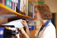 Pharmacist looking for files Stock Photos