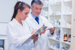 Pharmacist looking a medication for a prescription Stock Image