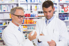Pharmacist looking a medication for a prescription Stock Photo