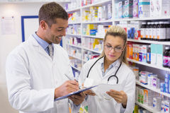 Pharmacist looking a medication for a prescription Stock Photos