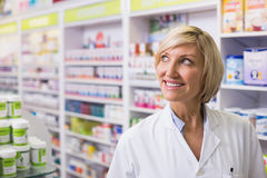 Pharmacist looking up Royalty Free Stock Image