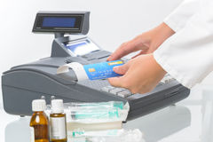 Pharmacist or medical doctor using cash register Royalty Free Stock Images