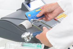 Pharmacist or medical doctor using cash register Stock Photography