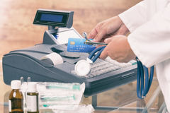 Pharmacist or medical doctor using cash register Stock Photos