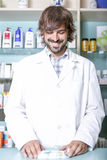 Pharmacist and medicaments Royalty Free Stock Photos