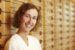 Pharmacist on medicine cabinet. Female pharmacist at medicine cabinet in pharmacy stock photo