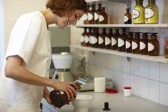 Pharmacist mixing ingredients Stock Photo