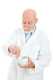 Pharmacist Mixing Medicine Stock Images