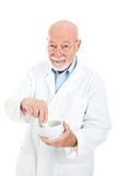 Pharmacist with Mortar and Pestle. Classic pharmacist with a mortar and pestle, isolated on white background Stock Photos