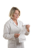 Pharmacist with package insert Stock Image
