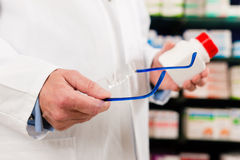 Pharmacist in pharmacy with medicament royalty free stock image