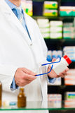 Pharmacist in pharmacy with medicament Stock Photo