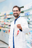 Pharmacist in pharmacy selling pharmaceuticals in bag Royalty Free Stock Photography