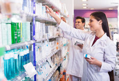 Pharmacist and pharmacy technician posing stock image