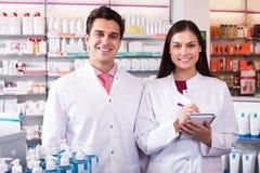 Pharmacist and pharmacy technician posing Royalty Free Stock Photo