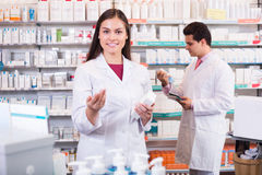 Pharmacist and pharmacy technician working Royalty Free Stock Images