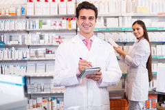 Pharmacist and pharmacy technician working Royalty Free Stock Image