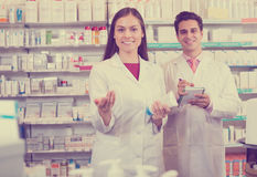 Pharmacist and pharmacy technician working Stock Photos