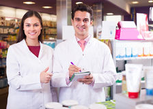 Pharmacist and pharmacy technician working Stock Image