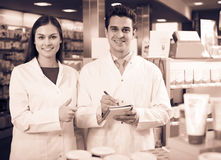 Pharmacist and pharmacy technician working Stock Photography