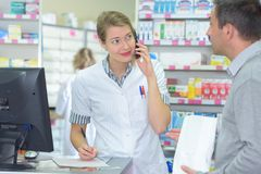 Pharmacist on the phone Stock Images