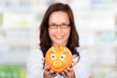 Pharmacist with piggybank Royalty Free Stock Images