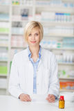 Pharmacist With Pill Bottle And Prescription Paper Stock Images