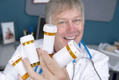 Pharmacist and pills Stock Photos