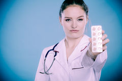 Pharmacist with pills medication. Royalty Free Stock Image