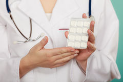 Pharmacist with pills medication. Stock Photos