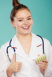 Pharmacist with pills medication. Ways of treatment. Pharmacist doctor in white medical unform apron showing pills. Woman specialist with stethoscope holding Stock Image