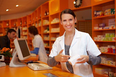 Pharmacist pointing to product Stock Photo