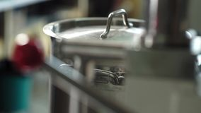 Pharmacist are preparing laboratory before the experiment. Metal pan standing on the table stock video footage