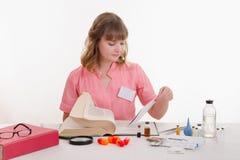 Pharmacist prescribing studies in the directory Stock Photo