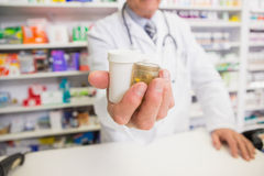 Pharmacist presenting medications on his hand Stock Image