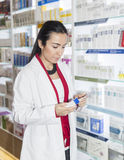 Pharmacist reading doctor prescription Royalty Free Stock Images