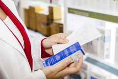 Pharmacist reading doctor prescription Royalty Free Stock Photography