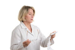 Pharmacist reading patient information sheet Stock Photos