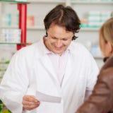 Pharmacist reading prescription Stock Image