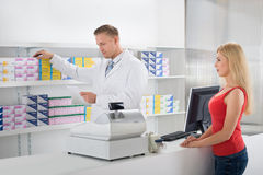 Pharmacist Reading Prescription Stock Photography