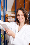 Pharmacist Reading Prescription Stock Photography