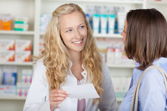 Pharmacist Reading Prescription Paper Stock Photography