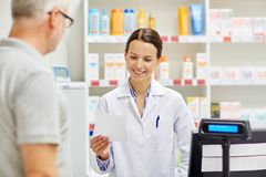 Pharmacist reading prescription and senior man Stock Photos